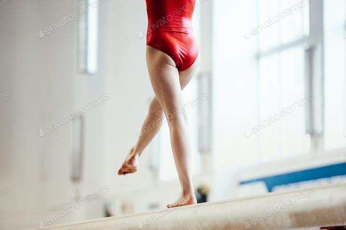 women athletes gymnast on balance beam