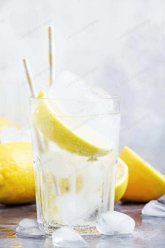 Summer cocktail with soda and lemons