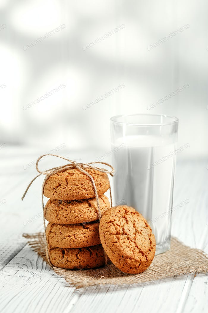 A glass of milk and delicious oatmeal cookies. Copy space. The c
