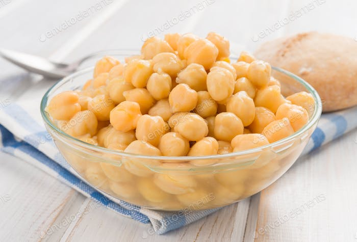 full of boiled chickpeas with bread and spoon bowl