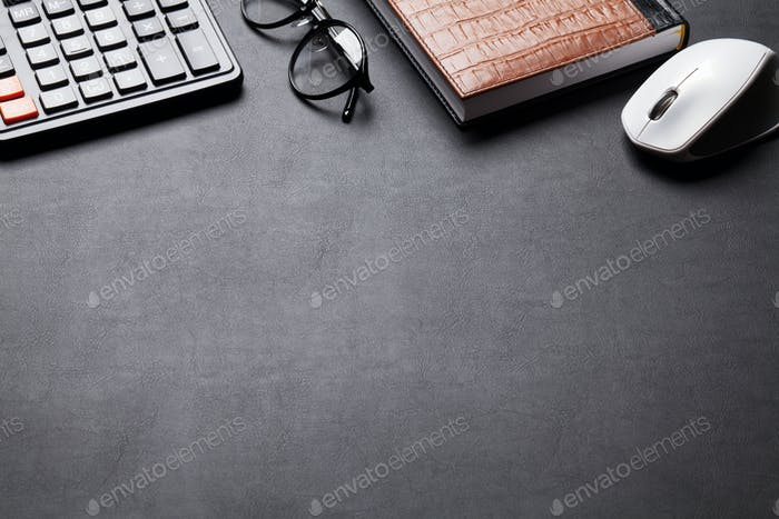 Office desk table with calculator, notebook and glasses