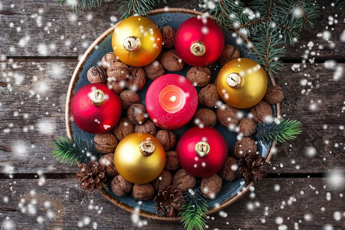 Red and golden Christmas balls on plate