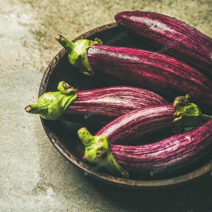 Fresh raw Fall harvest purple aubergines, square crop
