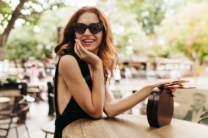 Attractive woman sitting in city cafe