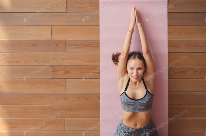 Young girl in a yoga class