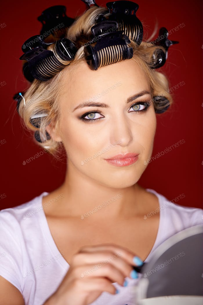 Beautiful young blond with her hair in curlers