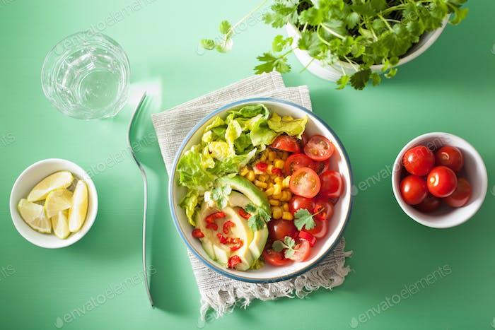 healthy vegan avocado salad with tomatoes and sweetcorn
