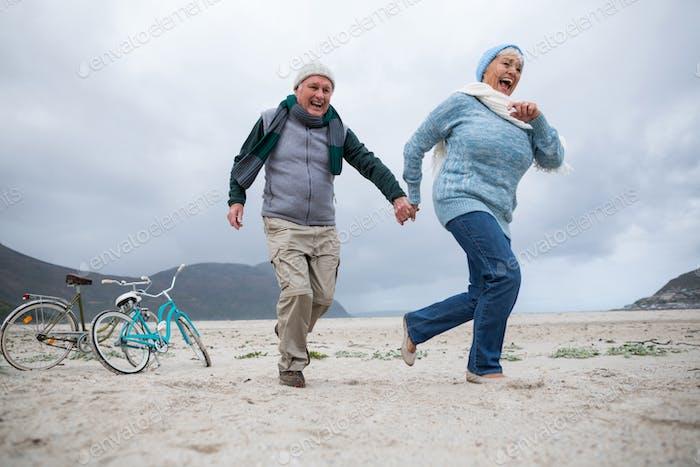 Senior couple having fun together at beach