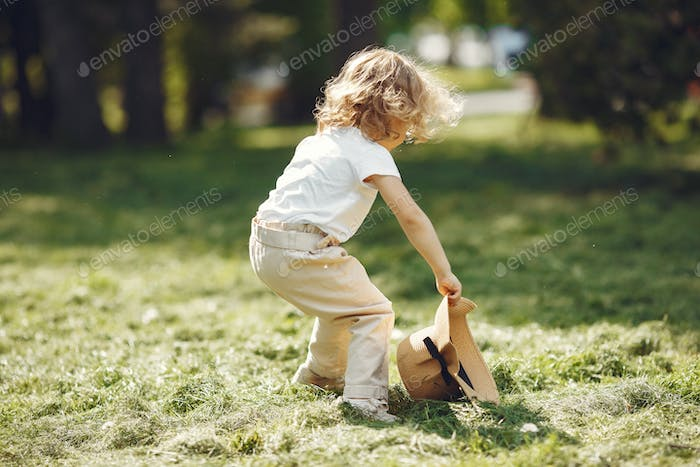Cute little girl playing in a summer park