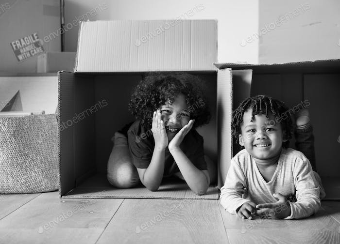 Young black kids moving to new house