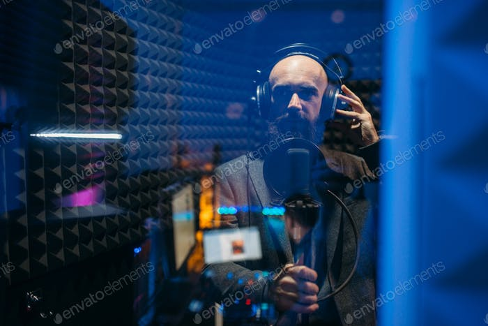 Male performer songs in audio recording studio