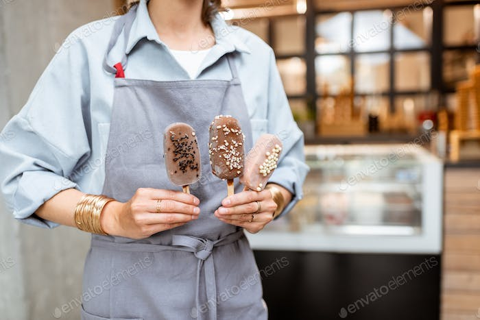 Seller with ice cream on a stick
