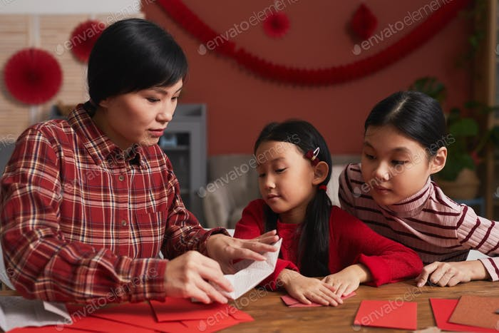 Creative Asian Woman And Daughters
