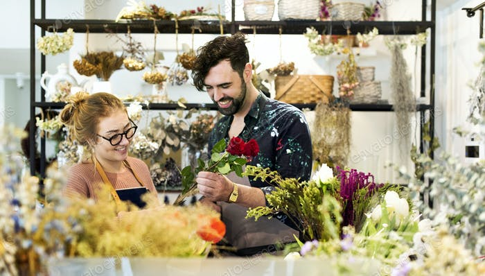 Florists making flower bouquet together