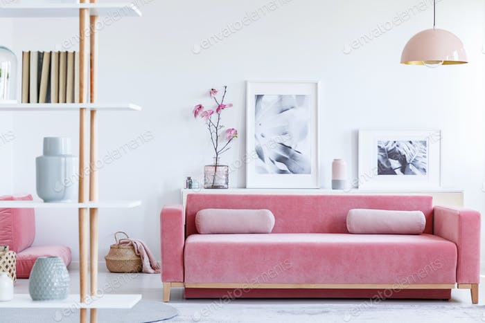 Real Photo Of A Pink Couch With Pillows In Front Shelf