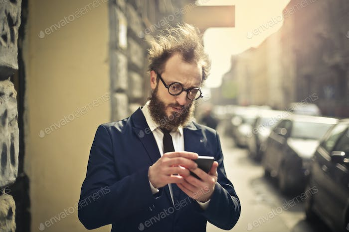 Man looking at a smartphone outdoor