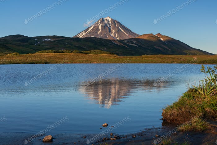 Stunning Volcano Landscape at Sunset: Reflection of Mountains in Alpine Lake