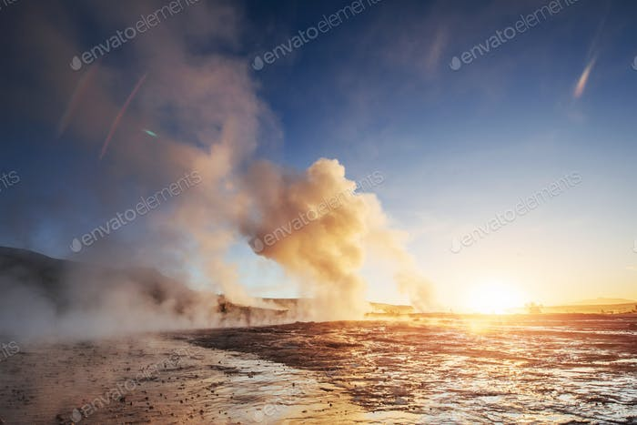 Strokkur geyser eruption in Iceland. Fantastic colors shine through the steam. Beautiful pink clouds