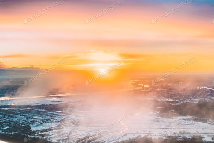 Riga, Latvia. Aerial View Of Sunrise Above City. View From High