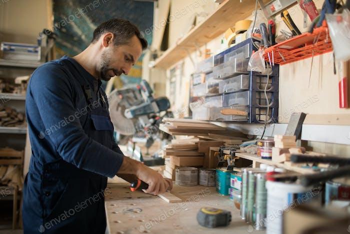 Mature Carpenter Making Furniture