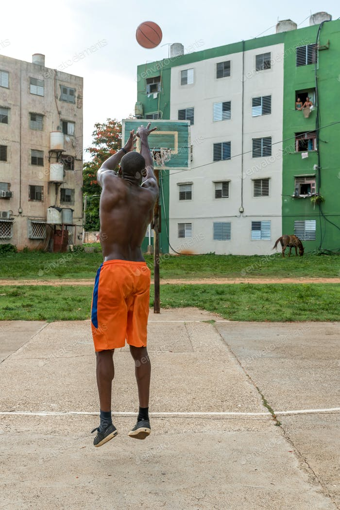Back View Of Black Man Playing Basketball On Outdoor Court in Cuba