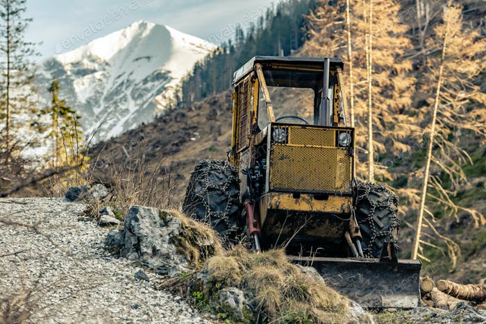 Bulldozer resting in high mountains after work