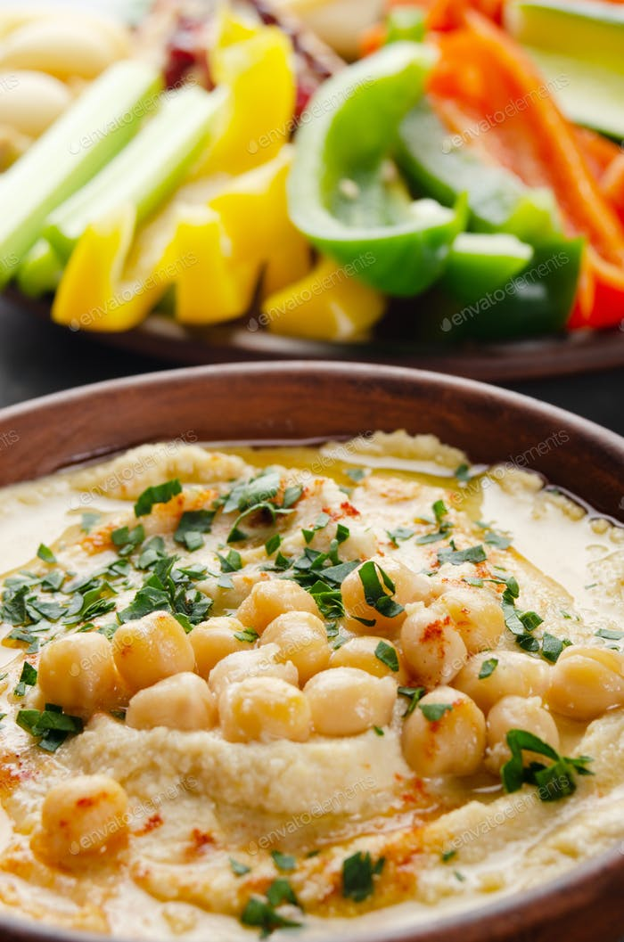 Low angle view at vegetable Hummus dip dish topped with chickpeas and olive oil