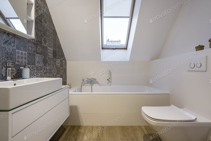 Attic bathroom with bathtub