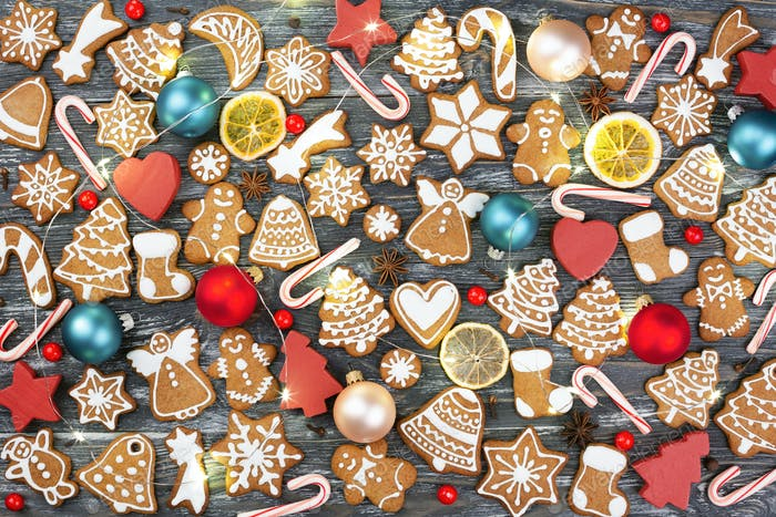Christmas Pattern Made of Gingerbread Cookies on Wooden Table.