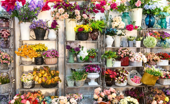 Flower shop, bouquets on shelf, florist business