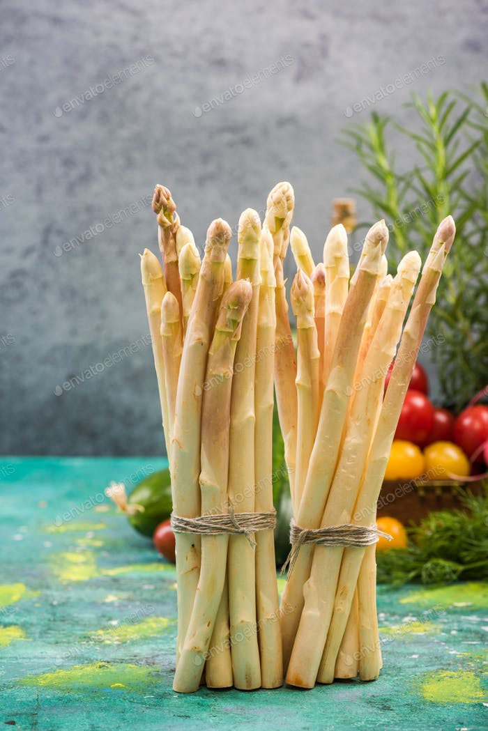 White asparagus bunch standing on table