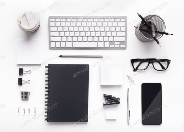 Corporate style supplies on workplace with keyboard