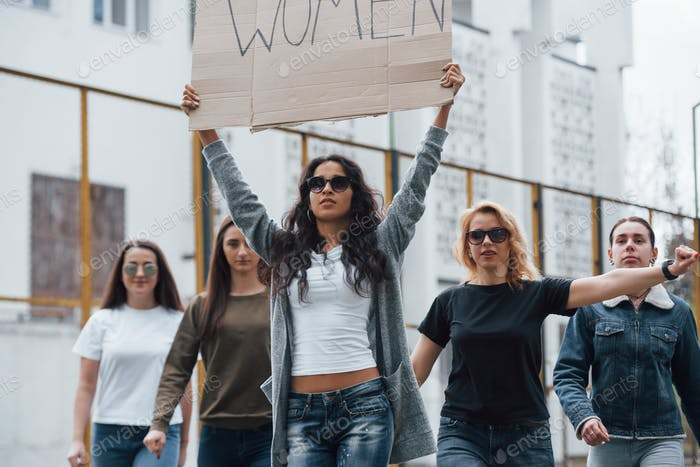 Caucasian ethnicity. Group of feminist women have protest for their rights outdoors
