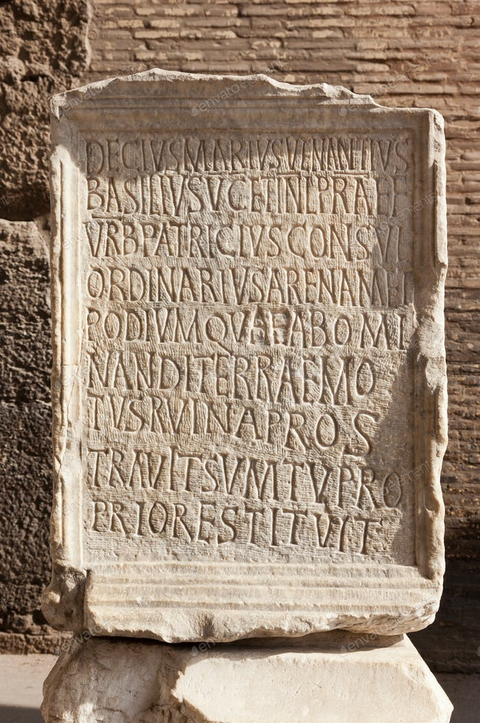 Ancient roman epigraph. Inscription located in Colosseum Arena, Roma, Italy.