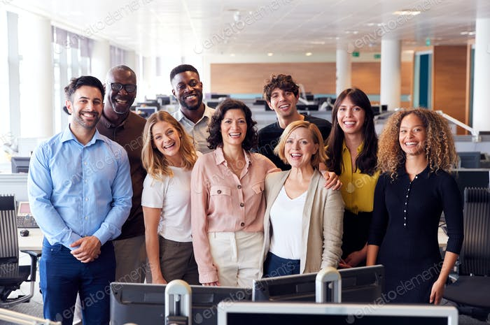 Portrait Of Smiling Business Team Working In Modern Office Together