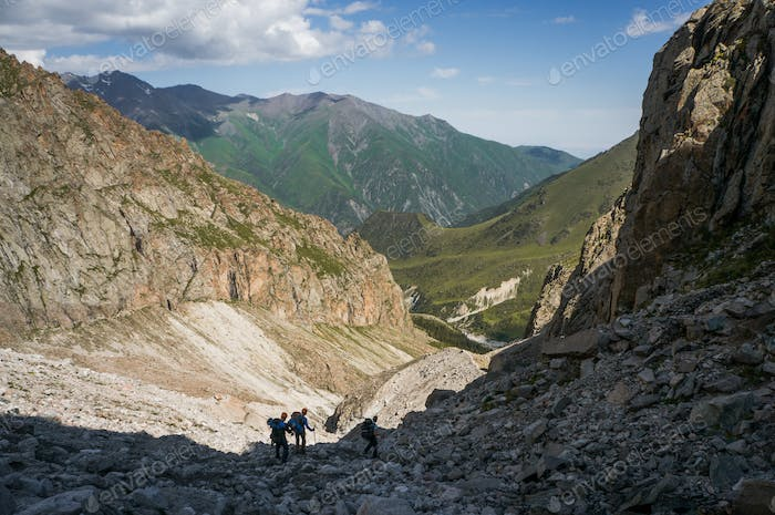 Three People Hiking in Mountains, Kyrgyzstan, Ala Archa