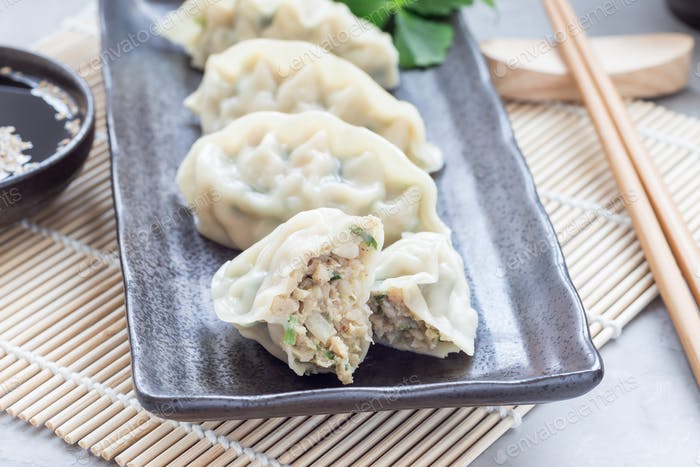 Steamed Korean dumplings Mandu with chicken meat and vegetables