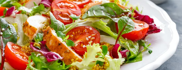 Fresh vegetable salad with grilled chicken meat