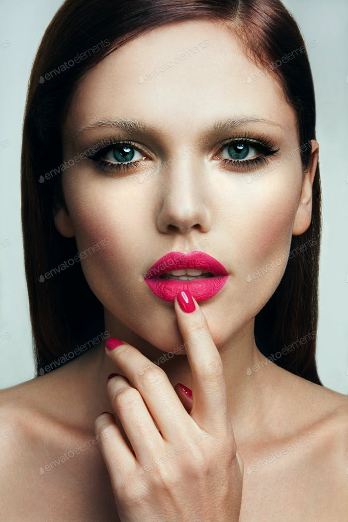 Portrait of beautiful girl with pink lips.