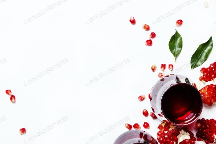 Fresh pomegranate juice in glass on white background, top view