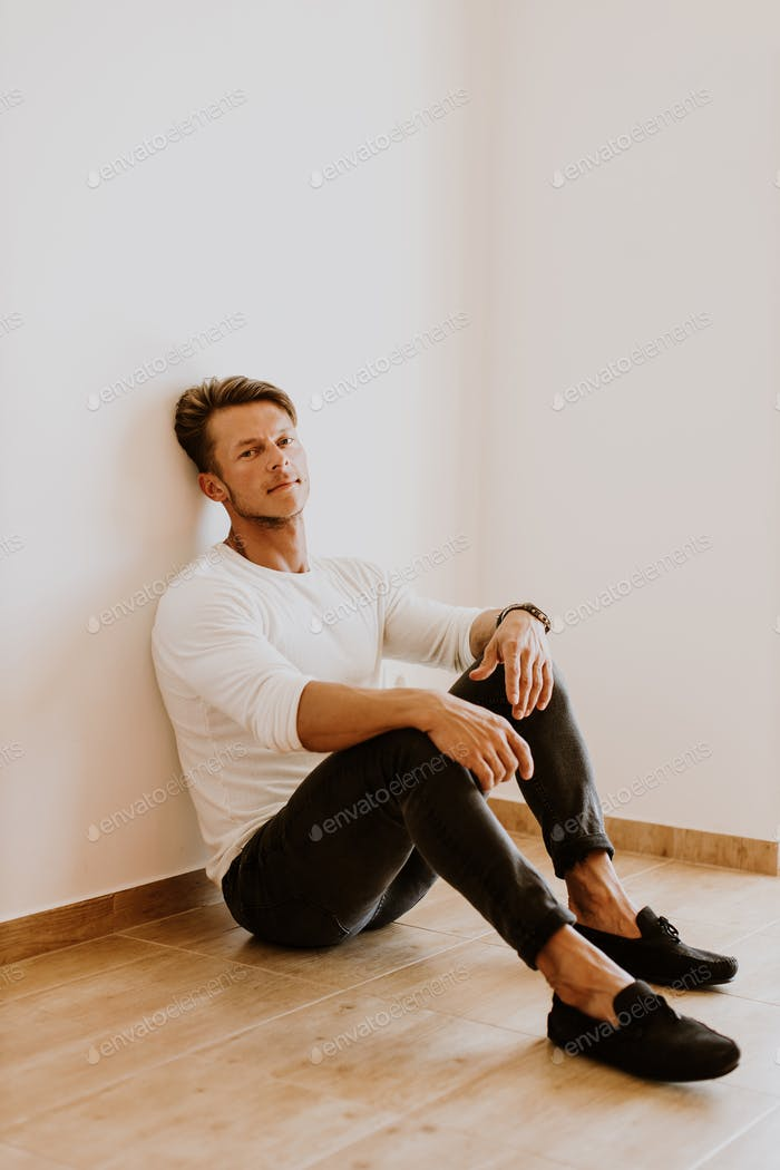 portrait of handsome man wearing casual at home