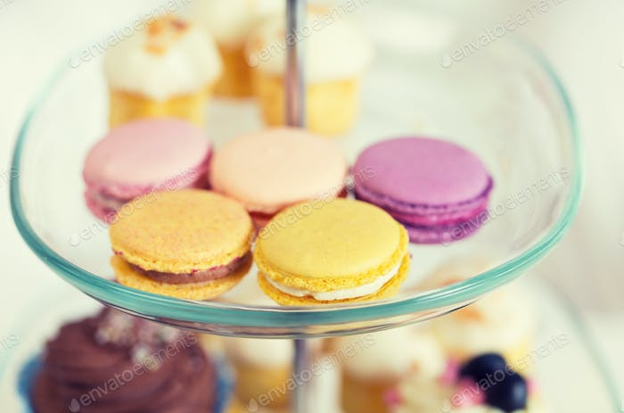 close up of cake stand with macaroon cookies
