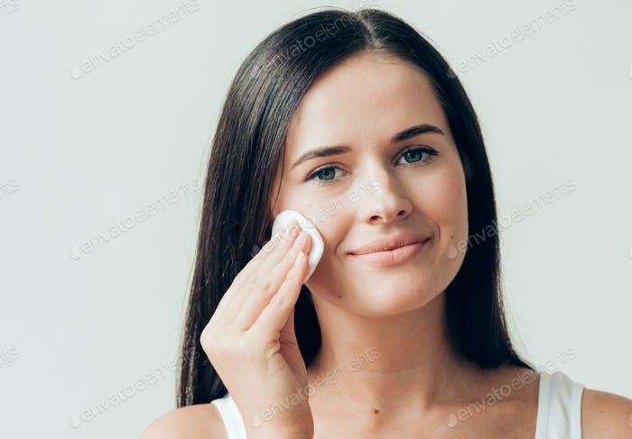 Cotton pad woman face remove makeup healthy skin natural makeup