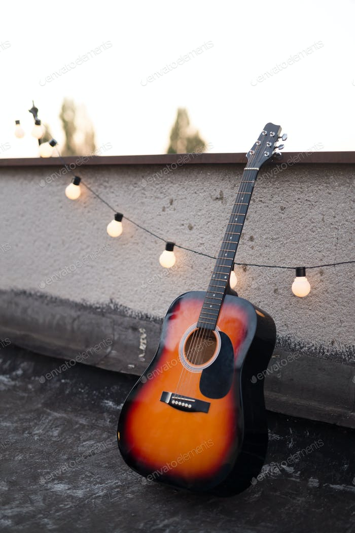 Picture of nice accoustic guitar on rooftop