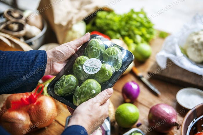 Closeup of hands holding brussels sprouts