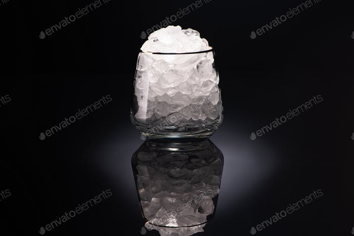 Transparent Glass With Ice on Black Background