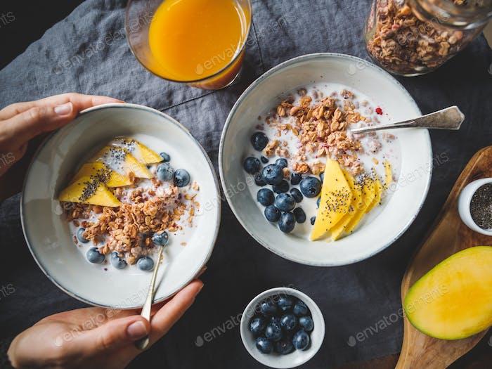Girl holds a breakfast bowl