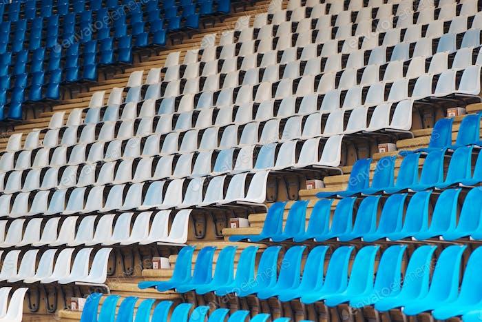 Blue and white plastic stadium seats