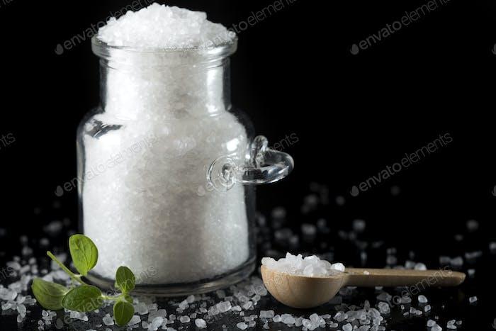 Glass jar filled with sea salt