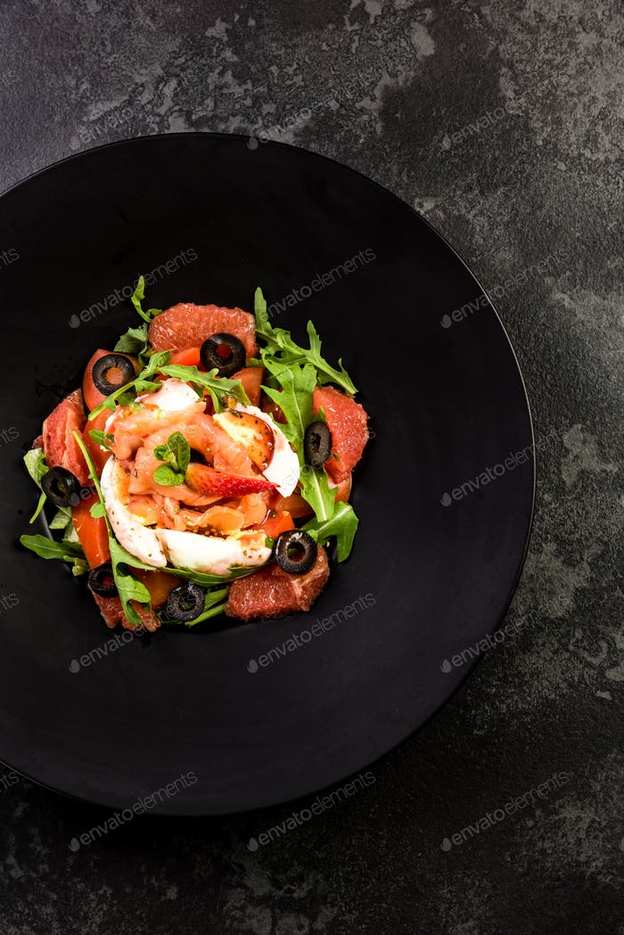 Fresh salad.Concept for a tasty and healthy meal. Dark stone bac